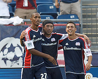 New England Revolution midfielder Lee Nguyen (24) celebrates his goal with teammates.  In a Major League Soccer (MLS) match, the New England Revolution (blue) defeated LA Galaxy (white), 5-0, at Gillette Stadium on June 2, 2013.