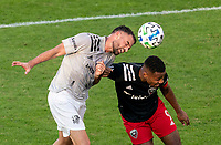 WASHINGTON, DC - NOVEMBER 8: Rudy Camacho #4 of the Montreal Impact heads the ball away from Ola Kamara #9 of D.C. United during a game between Montreal Impact and D.C. United at Audi Field on November 8, 2020 in Washington, DC.