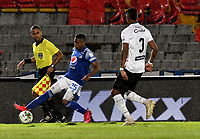 BOGOTA - COLOMBIA, 27-11-2020: Emerosn Rodriguez de Millonarios F. C. y Jose Junior Bueno de Once Caldas disputan el balon, durante partido entre Millonarios F. C. y Once Caldas de la fecha 1 por la Liguilla BetPlay DIMAYOR 2020 jugado en el estadio Nemesio Camacho El Campin de la ciudad de Bogota. / Emerosn Rodriguez of Millonarios F. C. and Jose Junior Bueno of Once Caldas figth for the ball, during a match between Millonarios F. C. and Once Caldas of the 1st date for the BetPlay DIMAYOR 2020 Liguilla played at the Nemesio Camacho El Campin Stadium in Bogota city. / Photo: VizzorImage / Luis Ramirez / Staff.