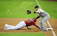 May 9, 2012; Phoenix, AZ, USA; Arizona Diamondbacks base runner Justin Upton dives back to first base during a pick off attempt to St. Louis Cardinals first baseman Allen Craig in the first inning at Chase Field. Mandatory Credit: Mark J. Rebilas-