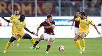 Calcio, Serie A: Frosinone vs Roma. Frosinone, stadio Comunale, 12 settembre 2015.<br /> Roma's Francesco Totti, center, is challenged by Frosinone's Raman Chibsah, left, and Paolo Sammarco during the Italian Serie A football match between Frosinone and Roma at Frosinone Comunale stadium, 12 September 2015.<br /> UPDATE IMAGES PRESS/Riccardo De Luca
