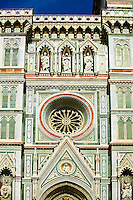 Roase window and facade of the Gothic-Renaissance Duomo of Florence,  Basilica of Saint Mary of the Flower; Firenza ( Basilica di Santa Maria del Fiore ).  Built between 1293 & 1436. Italy