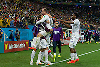 Wayne Rooney of England celebrates scoring a goal with team mates after making it 1-1