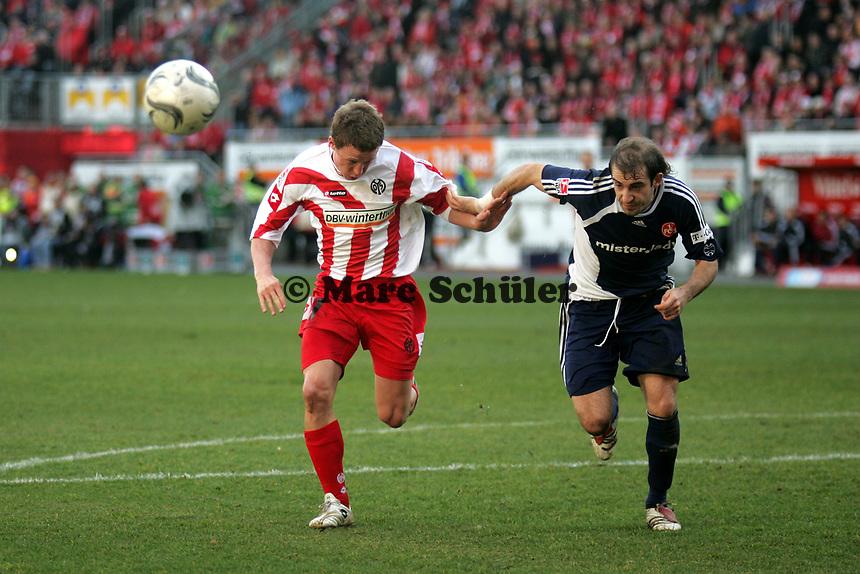 Zweikampf zwischen Petr Ruman (1. FSV Mainz 05, l.) und Michael Beauchamp (1. FC Nuernberg) +++ Marc Schueler +++ 1. FSV Mainz 05 vs. 1. FC Nuernberg, 24.02.2007, Stadion am Bruchweg Mainz +++ Bild ist honorarpflichtig. Marc Schueler, Kreissparkasse Grofl-Gerau, BLZ: 50852553, Kto.: 8047714