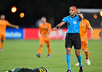 LAKE BUENA VISTA, FL - JULY 18: Referee Ismail Elfath shows a second yellow card and a subsequent red card to a player during a game between Houston Dynamo and Portland Timbers at ESPN Wide World of Sports on July 18, 2020 in Lake Buena Vista, Florida.
