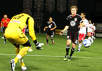 Dax McCarty (10) of D.C. United runs for the ball with Bouna Coundoul (18) of the New York Red Bulls during an MLS match at RFK Stadium, in Washington D.C. on April 21 2011. Red Bulls won 4-0.
