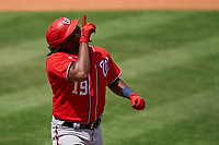 Washington Nationals Josh Bell (19) points to the sky as rounds the bases after hitting a home run during a Major League Spring Training game against the New York Mets on March 18, 2021 at Clover Park in St. Lucie, Florida.  (Mike Janes/Four Seam Images)