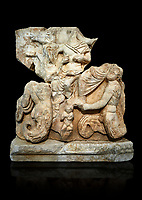 Roman Sebasteion relief  sculpture of Poseidon and Amphitrite,  Aphrodisias Museum, Aphrodisias, Turkey.   Against a black background.<br /> <br /> The two god-like tritons, Poseidon and Amphitrite, are seated on two sea horses accompanied by two fish legged tritons below. Between the tritons sits a sea-putto of baby triton. The male god is in the form of Poseidon crowned by his wife Amphitrite. Unusually he wears a military cloak and they might be an emperor and his wife (such as Claudius and Agrippina) in the guise of Poseidon and Amphitrite
