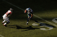 Sep 18, 2005; Seattle, WA, USA; Atlanta Falcons left corner back DeAngelo Hall #21 prepares to tackle Seattle Seahawks wide receiver Darrell Jackson #82 in the fourth quarter at Qwest Field. Mandatory Credit: Photo By Mark J. Rebilas