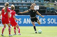 Brandi Chastain kicks the ball. FC Gold Pride defeated Washington Freedom 3-2 at Buck Shaw Stadium in Santa Clara, California on August 1, 2009.