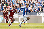 Carl Medjani of Deportivo Leganes runs past Ben Yedder of Sevilla FC during their La Liga match between Deportivo Leganes and Sevilla FC at the Butarque Municipal Stadium on 15 October 2016 in Madrid, Spain. Photo by Diego Gonzalez Souto / Power Sport Images