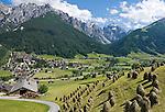 Austria, Tyrol, Stubai Valley, Community Neustift, district Kampl: traditional hay making, hay stacks, Stubai Alps