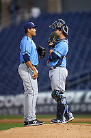 Charlotte Stone Crabs relief pitcher Yonny Chirinos (15) talks with catcher Nick Ciuffo (14) during a game against the Clearwater Threshers on April 12, 2016 at Bright House Field in Clearwater, Florida.  Charlotte defeated Clearwater 2-1.  (Mike Janes/Four Seam Images)