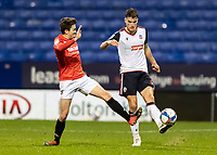 Bolton Wanderers' Ryan Delaney (right) clears under pressure from Salford City's Luke Burgess<br /> <br /> Photographer Andrew Kearns/CameraSport<br /> <br /> The EFL Sky Bet League Two - Bolton Wanderers v Salford City - Friday 13th November 2020 - University of Bolton Stadium - Bolton<br /> <br /> World Copyright © 2020 CameraSport. All rights reserved. 43 Linden Ave. Countesthorpe. Leicester. England. LE8 5PG - Tel: +44 (0) 116 277 4147 - admin@camerasport.com - www.camerasport.com