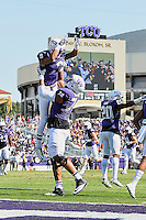 TCU offensive tackle Halapoulivaati Vaitai (74) celebrates touchdown by wide receiver Josh Doctson (9) by lifting him during first half of an NCAA football game, Saturday, October 18, 2014 in Fort Worth, Tex. TCU defeated Oklahoma State 42-9. (Mo Khursheed/TFV Media via AP Images)