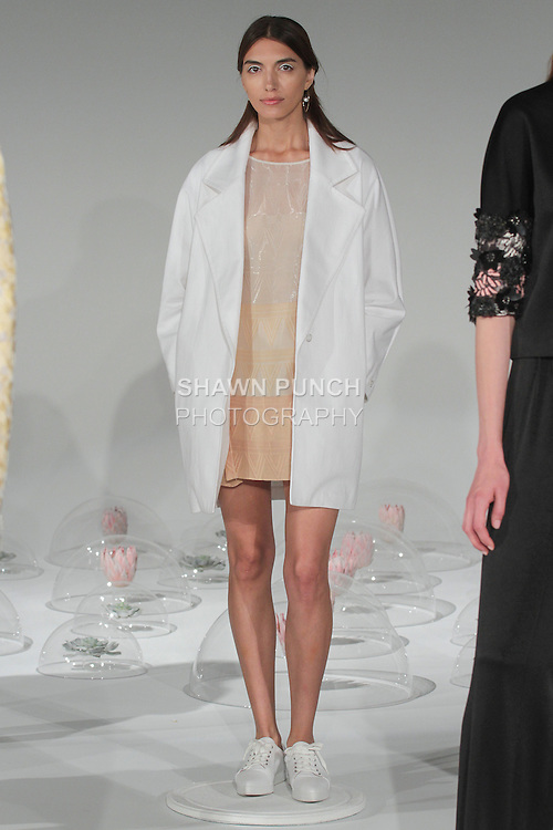"""Model poses in an outfit from the A Moi Spring Summer 2016 """"Retrograde"""" collection by Alejandra Alonso Rojas during New York Fashion Week Spring 2016."""