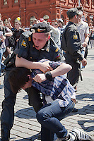 Moscow, Russia, 28/05/2011..A riot policeman seizes a gay rights activist at an attempted gay pride parade in central Moscow. Several dozen people were arrested during clashes as Russian nationalists attacked gay rights activists during their sixth attempt to hold a gay pride parade in the Russian capital.