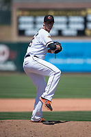 Sacramento RiverCats relief pitcher DJ Snelten (46) prepares to deliver a pitch during a Pacific Coast League against the Tacoma Rainiers at Raley Field on May 15, 2018 in Sacramento, California. Tacoma defeated Sacramento 8-5. (Zachary Lucy/Four Seam Images)