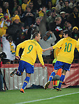 Kaka and Luis Fabiano celebrate after the second goal  during the 2010 FIFA World Cup South Africa Round of Sixteen match between Brazil and Chile at Ellis Park Stadium on June 28, 2010 in Johannesburg, South Africa.