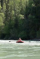 Kirsten Olsen and Nick Lynch float along the upper Kenai River canyon.