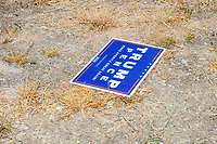 A Trump/Pence campaign sign lays in brown grass and dirt Donald Trump, Jr., son of president Donald Trump and a rising Republican political star, spoke at an outdoor campaign rally at The Lobster Trap in North Conway, New Hampshire, on Thu., Sept. 24, 2020.