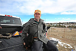 """Laramie County native Stuart Flynn poses with his dogs Winston, left, and Bailey, right, in the back off his truck at his home in northern Cheyenne Friday afternoon. Flynn said he loves the area because it affords many opportunities for outdoor recreation.  To participate in WTE Photo Editor Michael Smith's 2014 """"Our Faces: Portraits of Laramie County"""" project, call him at 633-3124 or 630-8388 or email msmith@wyomingnews.com. Michael Smith/staff"""