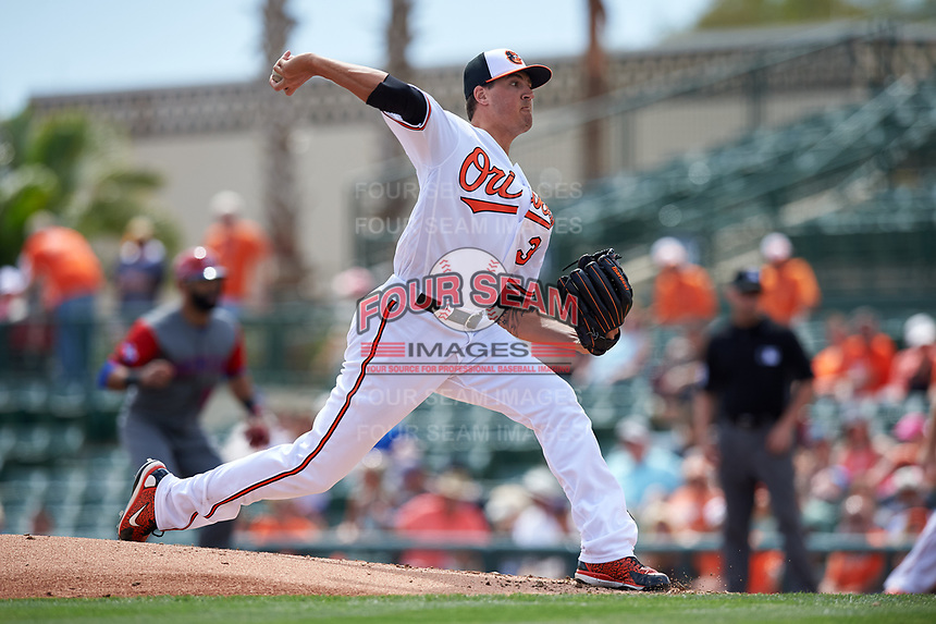 Baltimore Orioles starting pitcher Kevin Gausman (39) delivers a pitch during a Spring Training exhibition game against the Dominican Republic on March 7, 2017 at Ed Smith Stadium in Sarasota, Florida.  Baltimore defeated the Dominican Republic 5-4.  (Mike Janes/Four Seam Images)