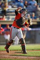 Aberdeen IronBirds catcher Jerry McClanahan (19) throws to first during a game against the Batavia Muckdogs on July 15, 2016 at Dwyer Stadium in Batavia, New York.  Aberdeen defeated Batavia 4-2.  (Mike Janes/Four Seam Images)
