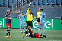 FOXBOROUGH, MA - SEPTEMBER 19: Referee Ramy Touchan issues a yellow card to Valentin Castellanos #11 of New York City FC during a game between New York City FC and New England Revolution at Gillette on September 19, 2020 in Foxborough, Massachusetts.