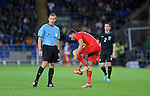 14th August 2013 - Cardiff - UK : Wales v Republic of Ireland - Vauxhall International Friendly at Cardiff City Stadium : Hal Robson-Kanu of Wales puts his shoe back on.