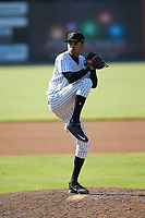Kannapolis Intimidators relief pitcher Kevin Escorcia (12) in action against the Greensboro Grasshoppers at Kannapolis Intimidators Stadium on August 5, 2018 in Kannapolis, North Carolina. The Intimidators defeated the Grasshoppers 9-0 in game two of a double-header.  (Brian Westerholt/Four Seam Images)