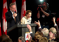Shawinigan (QC) CANADA - Nov 27 2000 File Photo -<br /> <br /> Liberal Party leader and Canadian Prime Ministers  and his wife Aline, smile at Liberal supporters on election night, November27, 2000 in his hometown riding of Shawinigan.