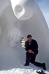 SNOW SCULPTOR TAKES A BREAK from WORK at the ANNUAL INTERNATIONAL<br />
