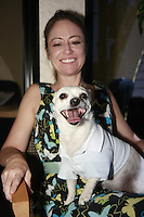 """Friday, June 20, 2008 was take your dog to work day at Caldwell Banker in Mission Beach, California USA.  Ally Edgerton and """"Winston""""."""