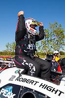 Apr 14, 2019; Baytown, TX, USA; NHRA funny car driver Robert Hight celebrates after winning the Springnationals at Houston Raceway Park. Mandatory Credit: Mark J. Rebilas-USA TODAY Sports
