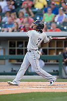Michael Martinez (7) of the Columbus Clippers follows through on his swing against the Charlotte Knights at BB&T BallPark on May 27, 2015 in Charlotte, North Carolina.  The Clippers defeated the Knights 9-3.  (Brian Westerholt/Four Seam Images)