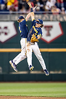 Michigan Wolverines shortstop Jack Blomgren (2) and outfielder Jesse Franklin (7) celebrate beating the Florida State Seminoles during the NCAA College World Series on June 17, 2019 at TD Ameritrade Park in Omaha, Nebraska. Michigan defeated Florida State 2-0. (Andrew Woolley/Four Seam Images)