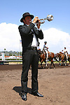 The bugler blows the call to post for the next race at the Del Mar Racetrack in Del Mar, California.