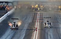Feb. 22, 2013; Chandler, AZ, USA; NHRA top fuel dragster driver Leah Pruett (left) races alongside Brittany Force during qualifying for the Arizona Nationals at Firebird International Raceway. Mandatory Credit: Mark J. Rebilas-