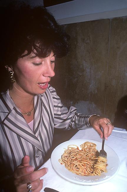 Woman Eating Pasta, Trattoria Settimio, Rome, Latium, Italy