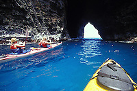 Kayak paddling through caves on Kauai's Na Pali Coast