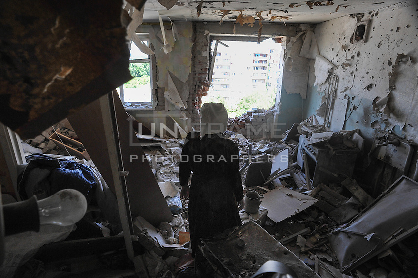 A woman inside her flat destroyed by the Ukrainian forces shelling on Kramatorsk on 02 July 2014, Ukraine
