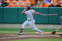 Florida State Seminoles left fielder DJ Stewart #8 swings at a pitch during a game against the Clemson Tigers at Doug Kingsmore Stadium on March 22, 2014 in Clemson, South Carolina. The Seminoles defeated the Tigers 4-3. (Tony Farlow/Four Seam Images)