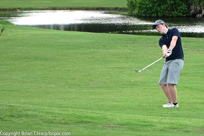 A golfer hits a chip shot of the 16th hole, Daytona Beach Golf Course, Daytona Beach, Florida, July 2014.  (Photo by Brian Cleary/www.bcpix.com)