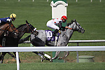 Paradise Bound with Kent Desormeaux (red cap) wins the 7th race at Keeneland Race Course. 04.02.2010