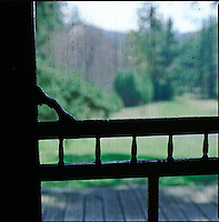 Silhouetted screen door with view of nature outdoors<br />