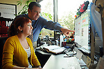 Colin Hageney consults with graphic designer Lindsey Bowsher at Bullpen Marketing Tuesday Feb. 26, 2013.(Dave Rossman/ For the Chronicle)