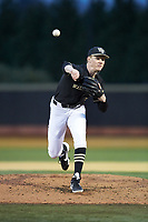 Wake Forest Demon Deacons relief pitcher William Fleming (38) delivers a pitch to the plate against the Illinois Fighting Illini at David F. Couch Ballpark on February 16, 2019 in  Winston-Salem, North Carolina.  The Fighting Illini defeated the Demon Deacons 5-2. (Brian Westerholt/Four Seam Images)