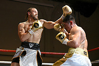 Josh Gooding (silver/black shorts) defeats Fernando Valencia during a Boxing Show at the Corn Exchange on 25th September 2021