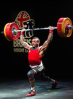 10 MAY 2014 - COVENTRY, GBR - Bradley Burrowes from the Empire Sports Club attempts to complete a lift during the men's 85kg category round at the British 2014 Senior Weightlifting Championships and final 2014 Commonwealth Games qualifying event round at the Ricoh Arena in Coventry, Great Britain. Burrowes' combined total for the event of 292kg makes him eligible for selection for the England team for the Commonwealth Games in Glasgow (PHOTO COPYRIGHT © 2014 NIGEL FARROW, ALL RIGHTS RESERVED)